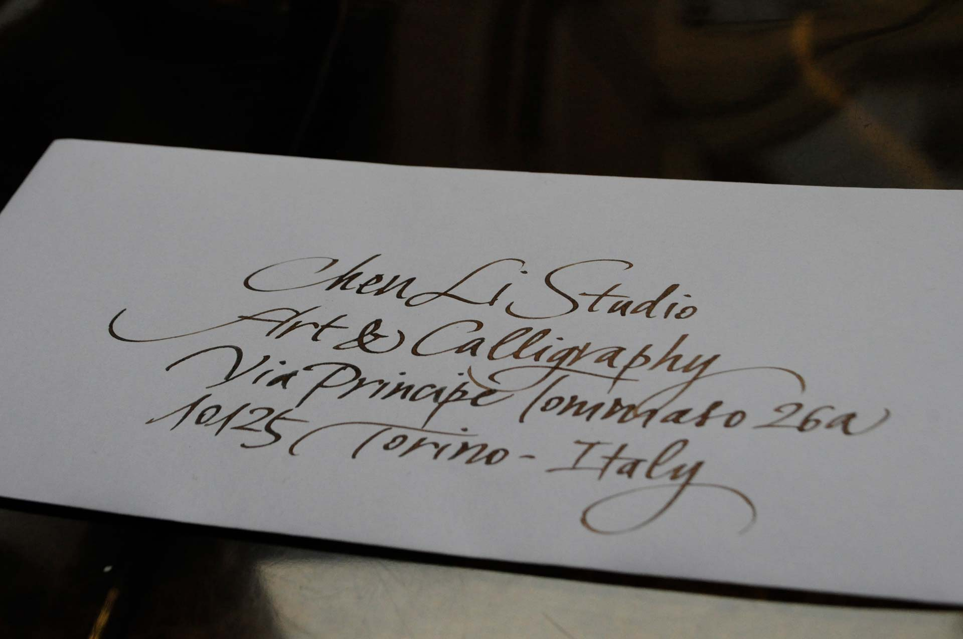 calligraphic address for envelopes in a classical handwriting in brown ink and pen by Chen Li